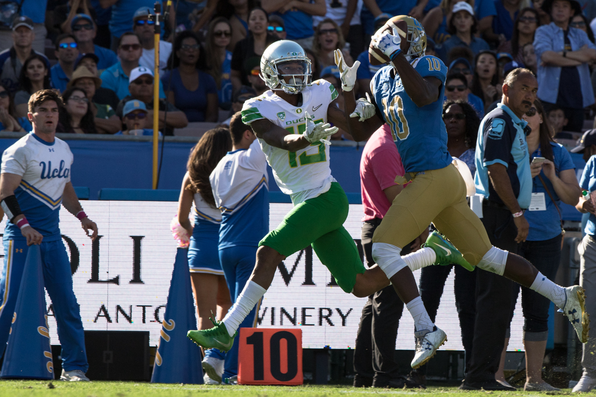 UCLA defensive back Colin Samuel (#10) intercepts a pass intended for Oregon wide receiver Dillon Mitchell (#13). The Oregon Ducks fell to the UCLA Bruins 14-31 after being shut out during the second half at the Rose Bowl Stadium in Pasadena, California.  This marks the third consecutive loss for the Ducks, dropping their record to 4-4 on the season.  Photo by Austin Hicks, Oregon News Lab