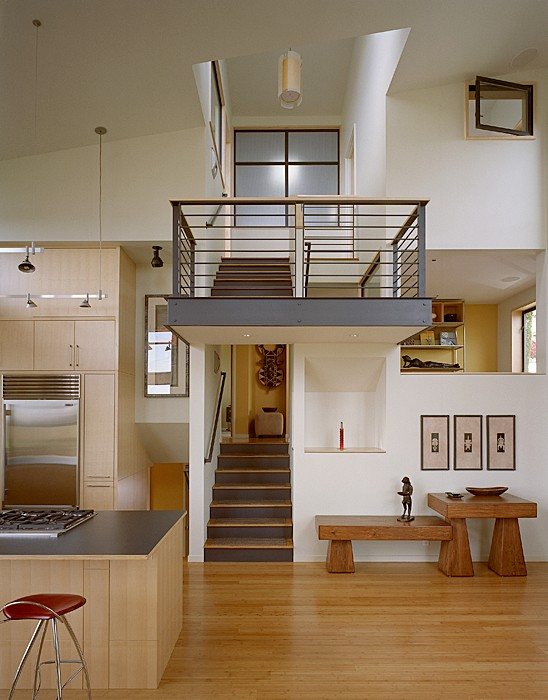 This Lynnwood project was completed by DeForest Architects creates a 'zipper' by opening up the stair, raising the roof and adding a fifth level.   (Image: Zipper House / Porch.com)