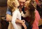 daughters kissing him.jpg