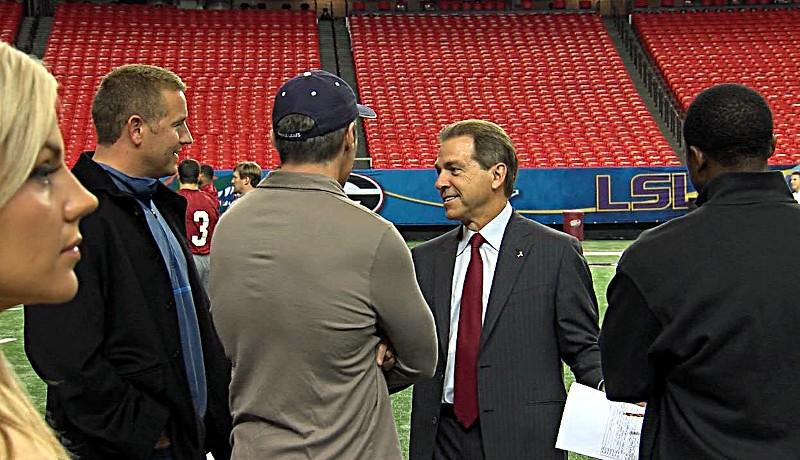 Alabama head coach Nick Saban talks with the ESPN Gameday crew Kirk Herbstreit, Chris Fowler and Desmond Howard as Samantha Steele watches practice.