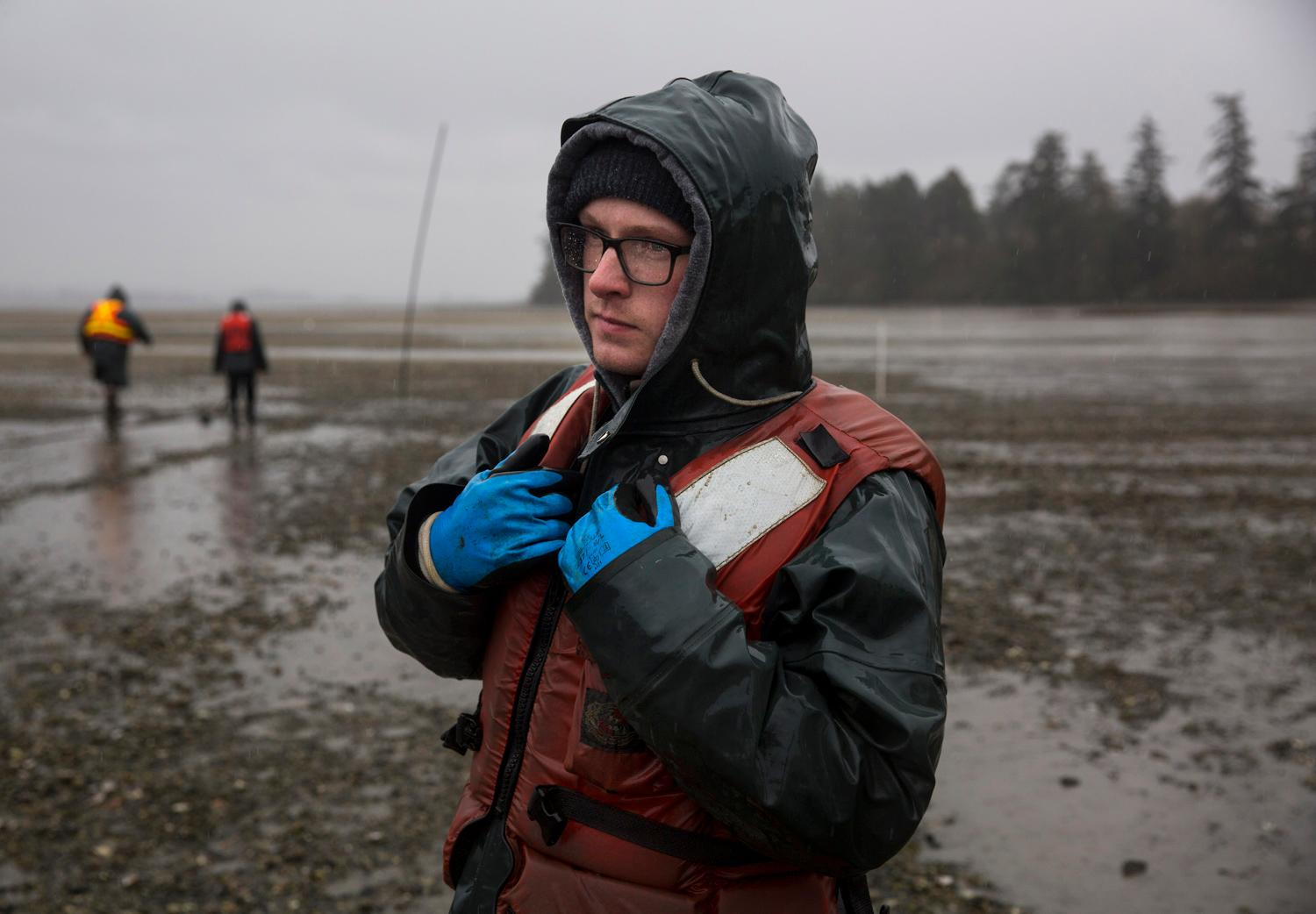 Samish flip bag farm manager Nolan Peltier stands in the cold as he waits to board a boat that will take him out to the oyster flats in Samish Bay. Taylor Shellfish Farms has its roots in shellfish farming in Washington State since the 1890s, and is now a proud leader of sustainable farming practices. You can try the tasty oysters at one of their oyster bars located in Queen Anne, Capitol Hill, Pioneer Square, or Bellevue. (Sy Bean / Seattle Refined)