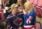 Airman turns tables on girlfriend at Stingrays game (6).jpg
