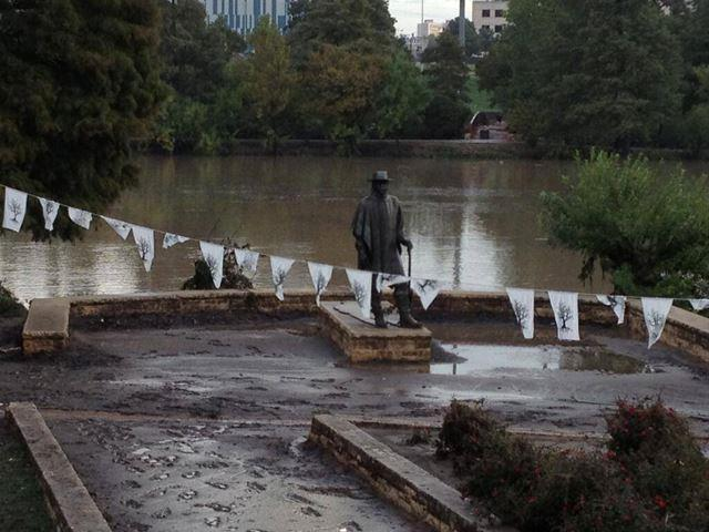 KEYE TV Reporter Adam Bennett got this shot of water flooding the Stevie Ray Vaughan statue on Auditorium Shores. Look at the mud.