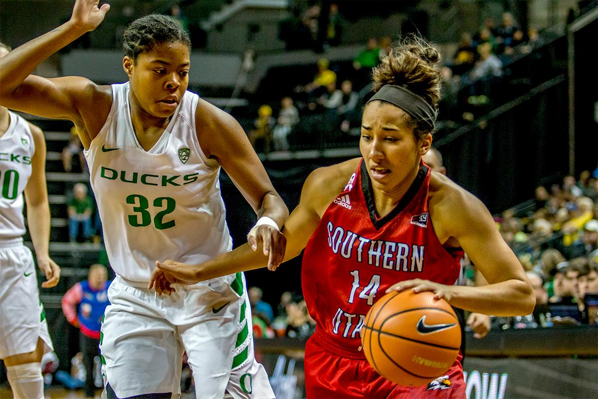 The Thunderbird's Breanu Reid (#14) and Oti Gildon (#32) run down the court as Reid looks for an opening. The University of Oregon Ducks women basketball team defeated the Southern Utah Thunderbirds 98-38 in Matthew Knight Arena Saturday afternoon. The Ducks had four players in double-digits: Ruthy Hebard with 13; Mallory McGwire with 10; Lexi Bando with 17 which included four three-pointers; and Sabrina Ionescu with 16 points. The Ducks overwhelmed the Thunderbirds, shooting 50% in field goals to South Utah's 26.8%, 53.8% in three-pointers to 12.5%, and 85.7% in free throws to 50%. The Ducks, with an overall record of 8-1, and coming into this game ranked 9th, will play their next home game against Ole Miss on December 17. Photo by August Frank, Oregon News Lab