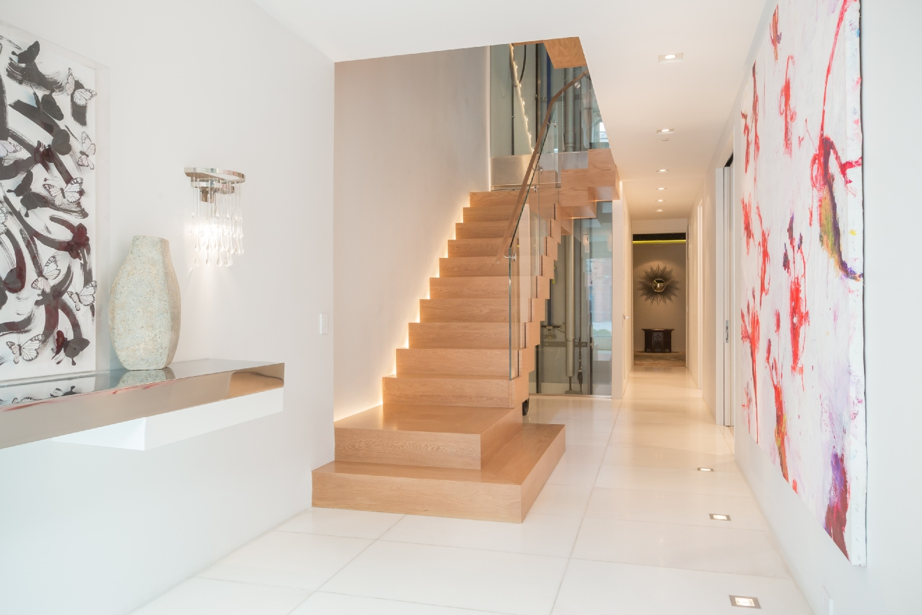 This Georgetown listing has our modern-loving little hearts a flutter. The 6-bedroom, 4.5-bath, 5,600-square-foot townhouse is awash in modern touches from the gorgeous floating staircase that is the centerpiece of the main level to the glass elevator and bamboo-filled, Boffi-designed master bathroom that will transport you to Bali. (Image: Sean Shanahan)