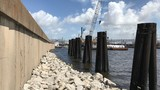 'Super sack' sandbags on standby at breached levee in case of storm