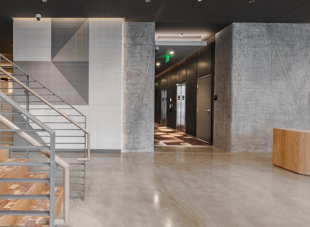 The lower level apartments' brand new warehouse-inspired vibe carries over to AMLI Arc's sleek lobby.
