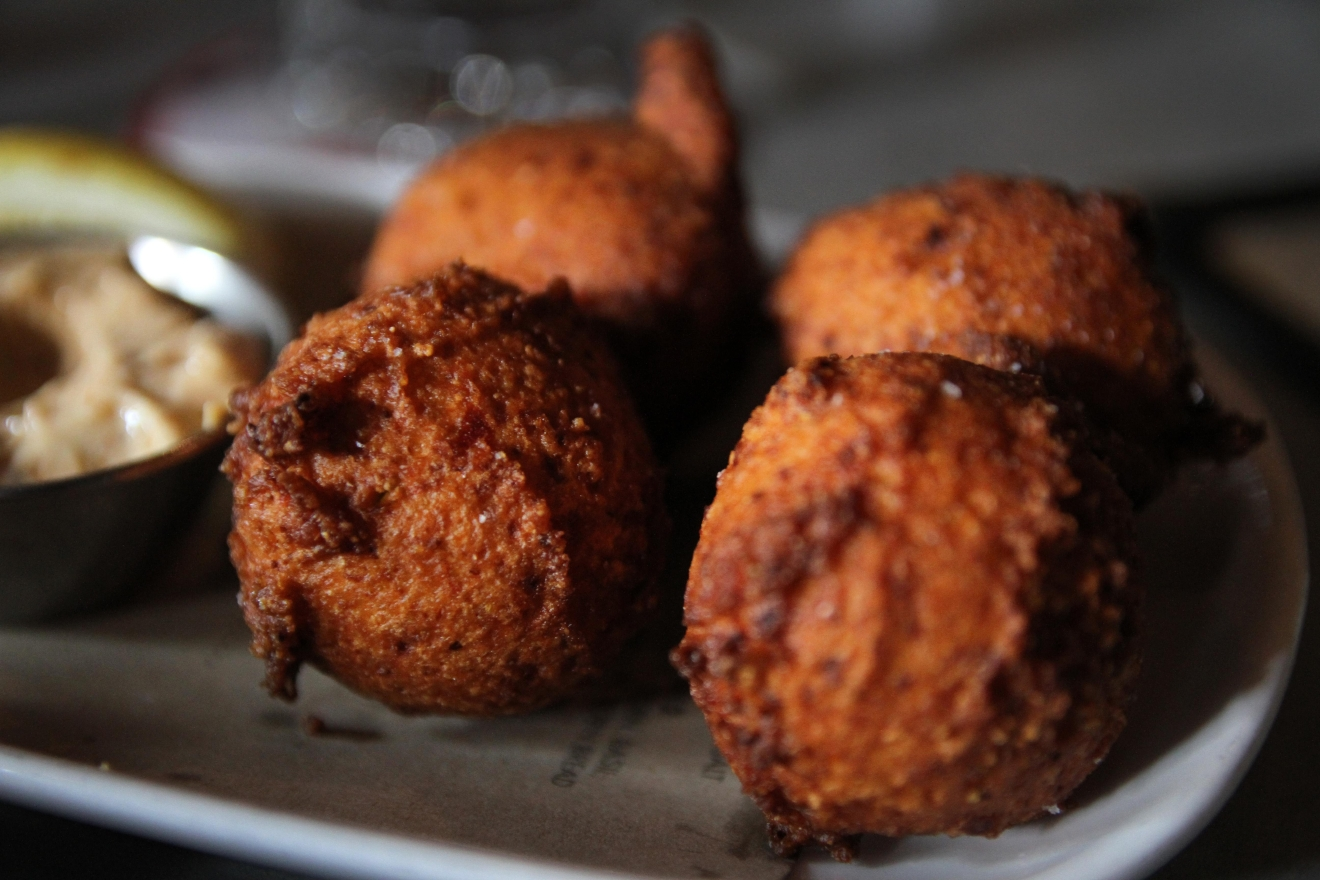 Even if oysters aren't your thing, the hush puppies are tasty and sharing is overrated anyways. (Amanda Andrade-Rhoades/DC Refined)