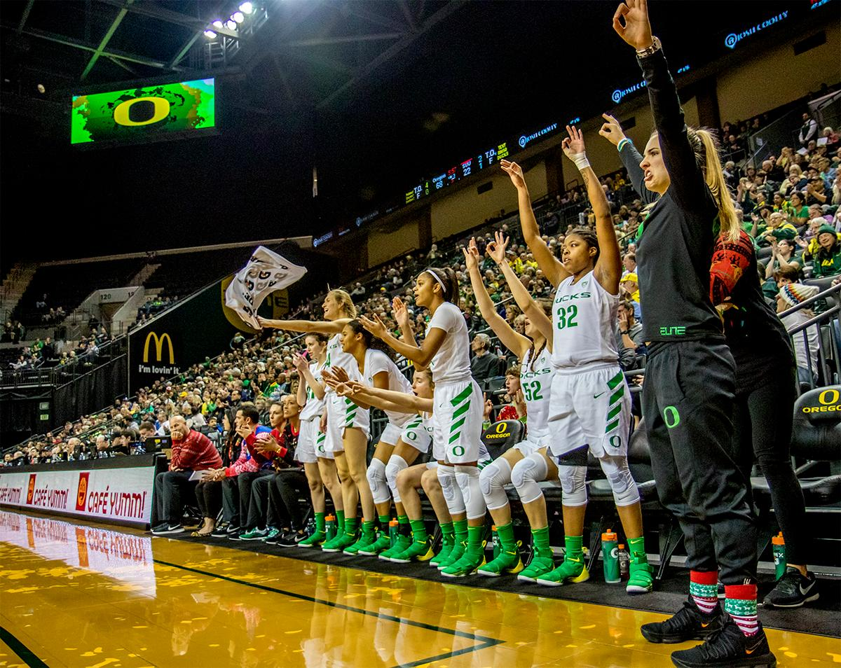 The Duck's team celebrates a basket in the game against the Southern Utah Thunderbirds. The University of Oregon Ducks women basketball team defeated the Southern Utah Thunderbirds 98-38 in Matthew Knight Arena Saturday afternoon. The Ducks had four players in double-digits: Ruthy Hebard with 13; Mallory McGwire with 10; Lexi Bando with 17 which included four three-pointers; and Sabrina Ionescu with 16 points. The Ducks overwhelmed the Thunderbirds, shooting 50% in field goals to South Utah's 26.8%, 53.8% in three-pointers to 12.5%, and 85.7% in free throws to 50%. The Ducks, with an overall record of 8-1, and coming into this game ranked 9th, will play their next home game against Ole Miss on December 17. Photo by August Frank, Oregon News Lab
