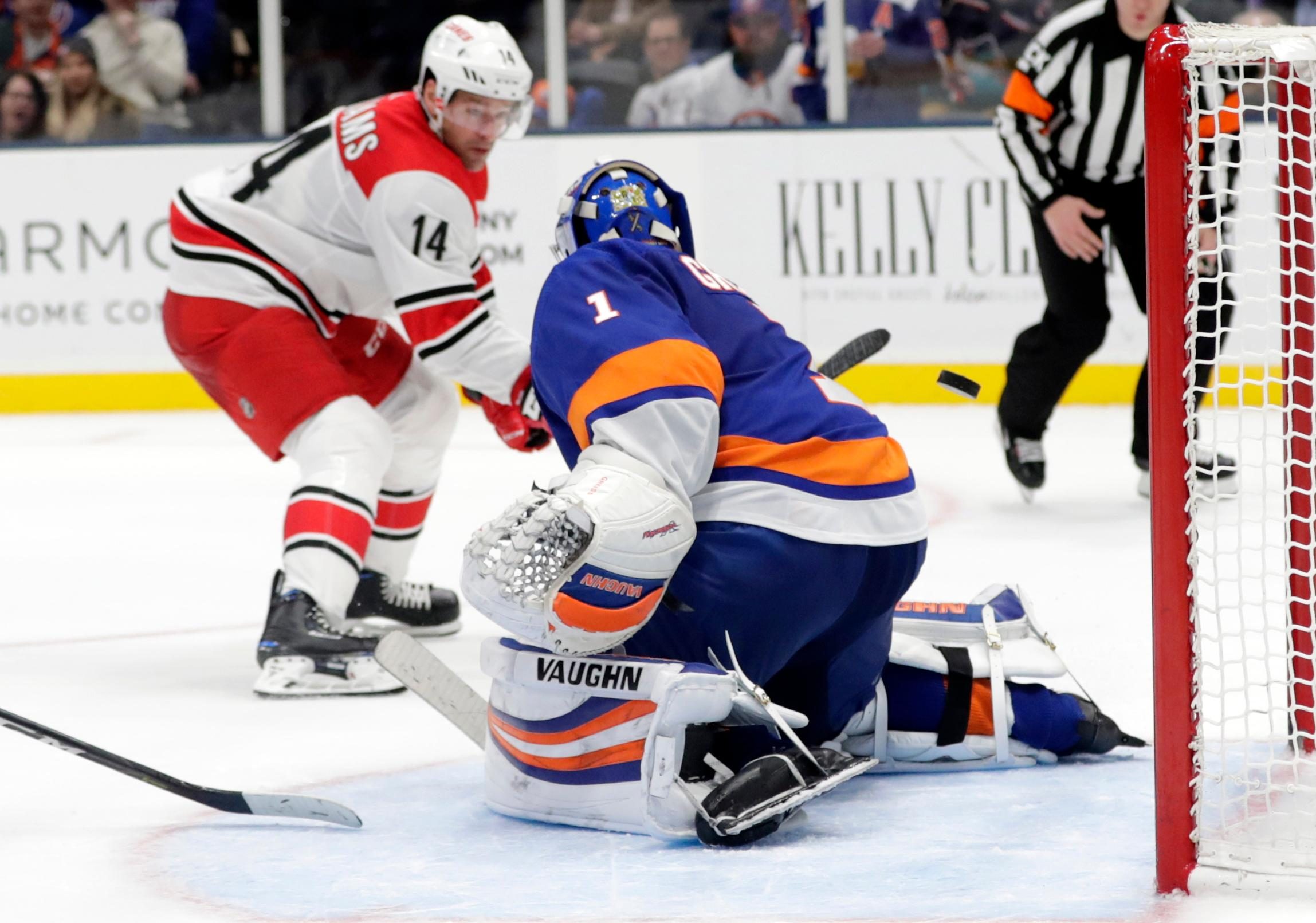 Carolina Hurricanes' Justin Williams (14) shoots the puck past New York Islanders goaltender Thomas Greiss (1) for a goal during the third period of an NHL hockey game Tuesday, Jan. 8, 2019, in New York. The Hurricanes won 4-3. (AP Photo/Frank Franklin II)