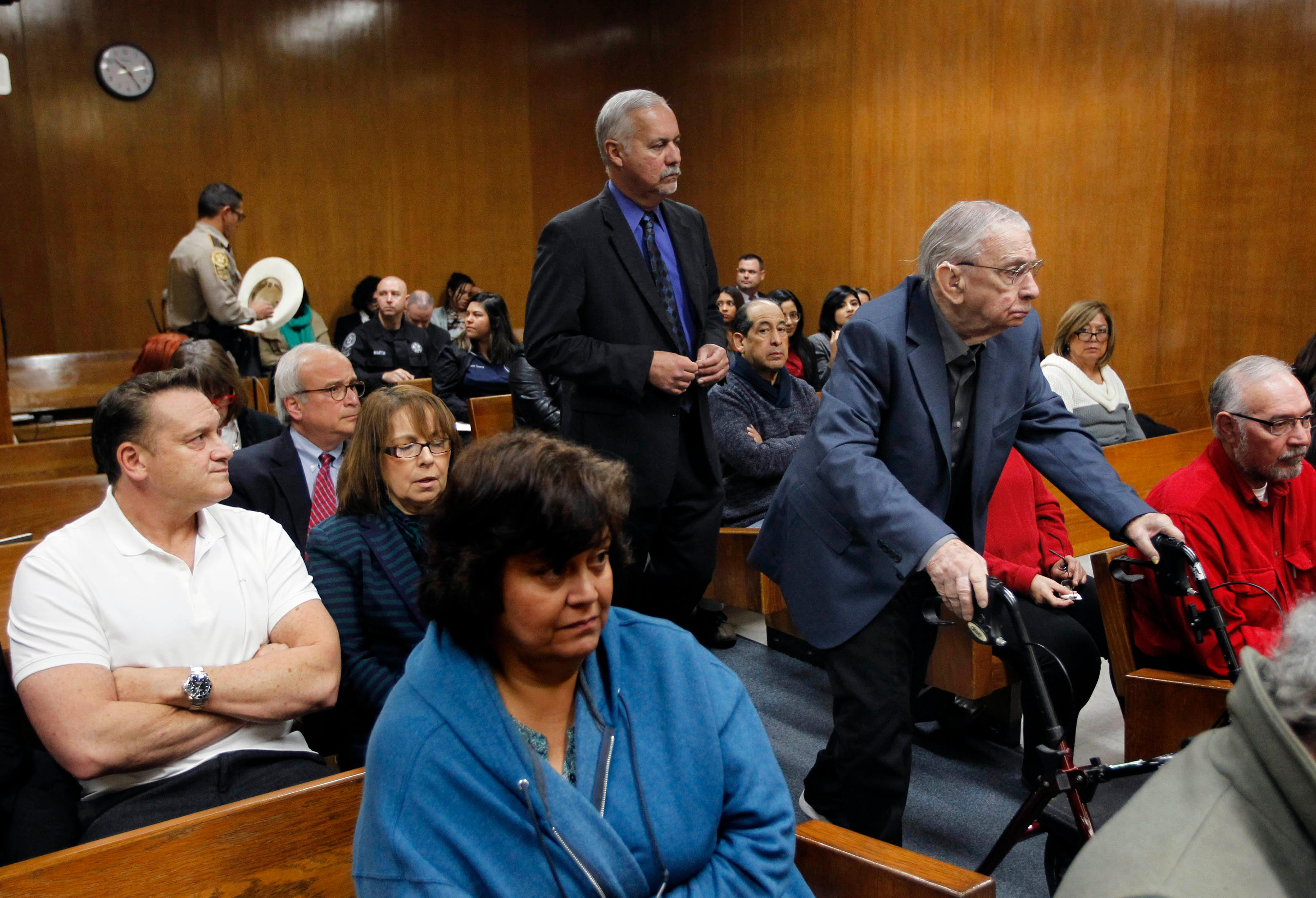 John Bernard Feit enters the 92nd state District Court for the fifth day of his trial for the murder of Irene Garza as Nick Cavazos, left, and Lynda de la Vida, second from left, both extended members of Irene Garza, sits in court Wednesday, December 6, 2017, at the Hidalgo County Courthouse in Edinburg.  (Nathan Lambrecht/The Monitor/Pool)