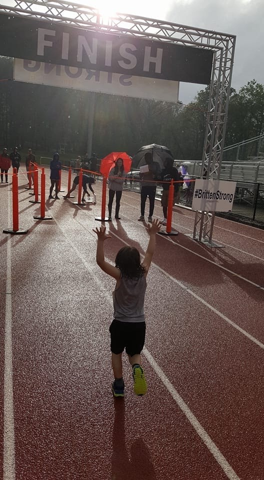 Britten's Race to Recovery 5K was April 27, Britten Olinger's birthday. It was raining but they raised $12,500. Ingles from Black Mountain donated $2,500. Before the race started, the participants FaceTimed Britten and sang him happy birthday. (Photo credit: Brittenstrong)