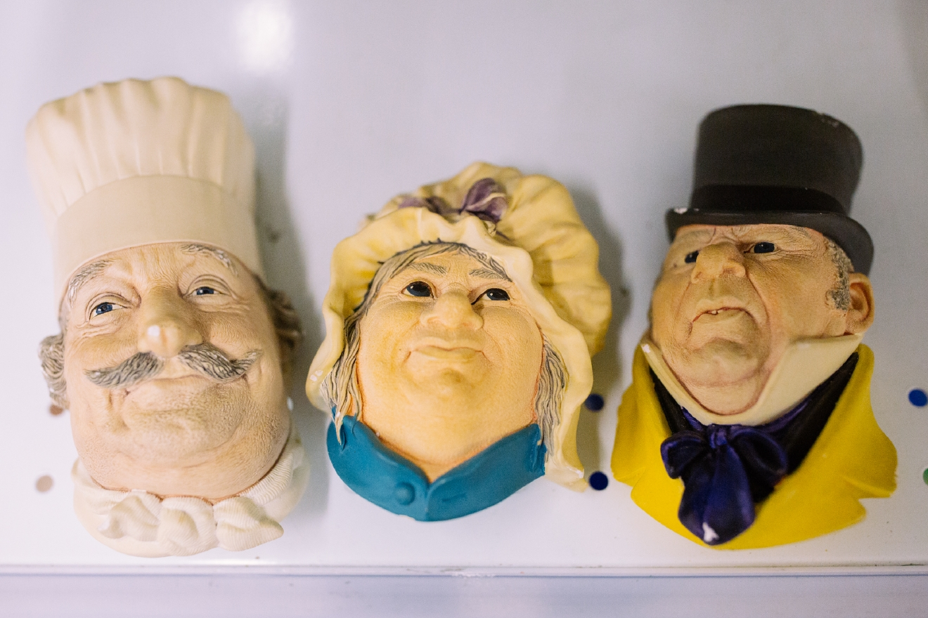 Wall hanging face statues . $5.99 each  Are you going to a White Elephant Gift Exchange this year? We headed to our local Value Village to give you some gift ideas and how much they cost. (Image: Joshua Lewis / Seattle Refined)