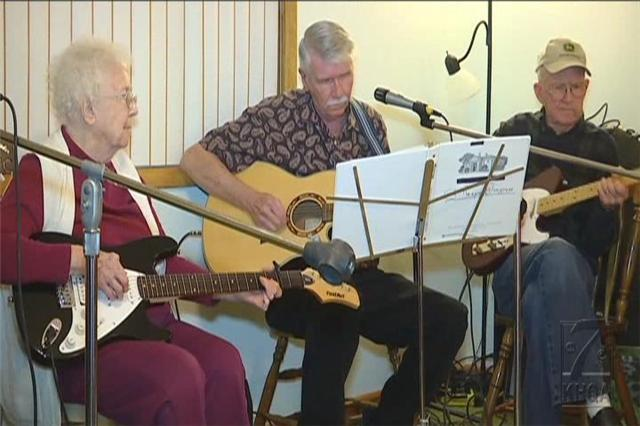 Lucille Gillespie, 94, plays with her sons, Kenny and Larry Gillespie, at a Gillespie jam.