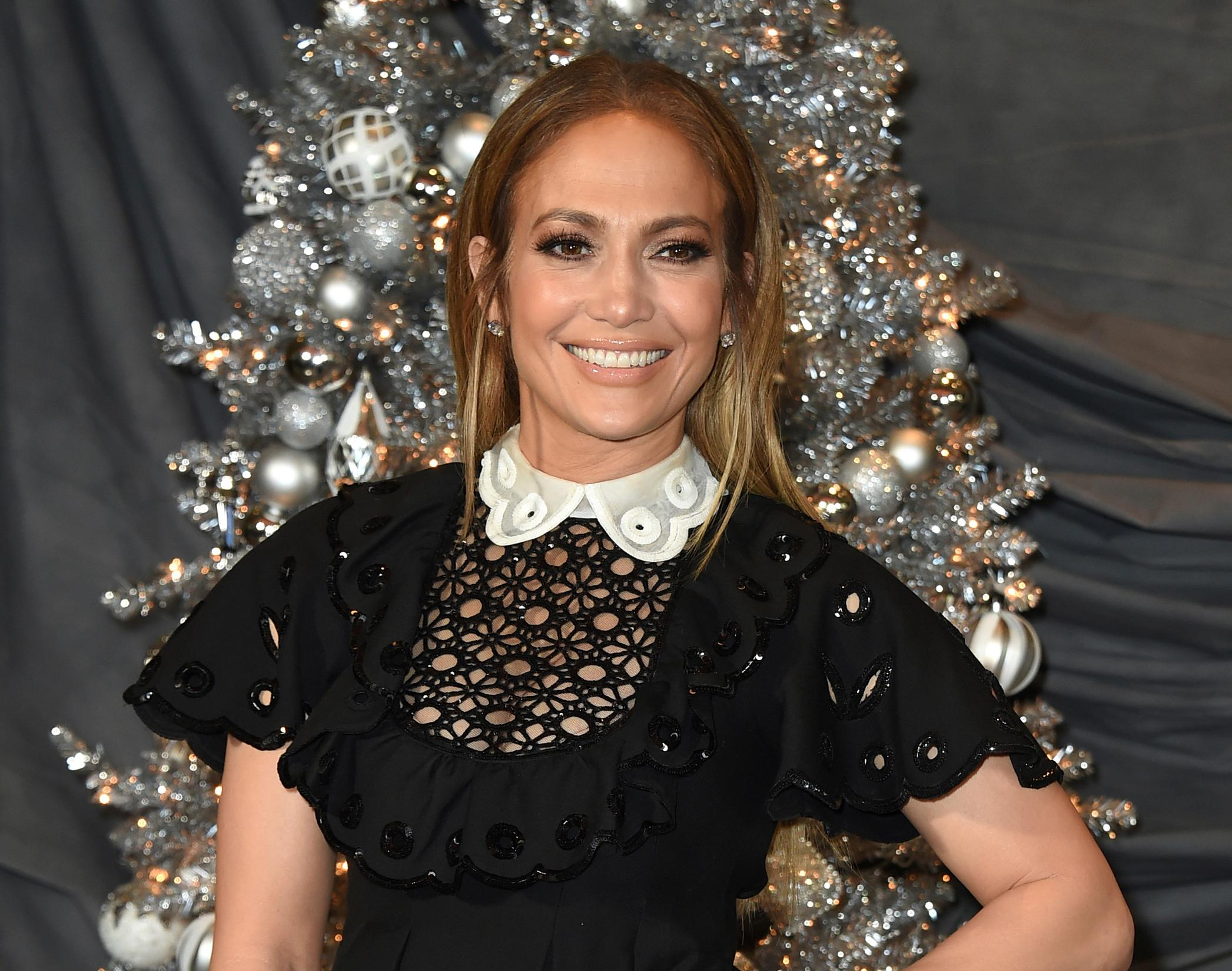 "FILE - In this Dec. 9, 2018 file photo, Jennifer Lopez attends a photocall for ""Second Act"" at the Four Seasons in Los Angeles. In the film, in theaters nationwide Friday, her business savvy character gets a shot to prove herself to Madison Avenue's elite thanks to an embellished resume. (Photo by Jordan Strauss/Invision/AP, File)"