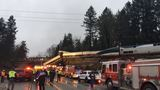 PHOTOS: Derailed Amtrak train over I-5 north of Olympia