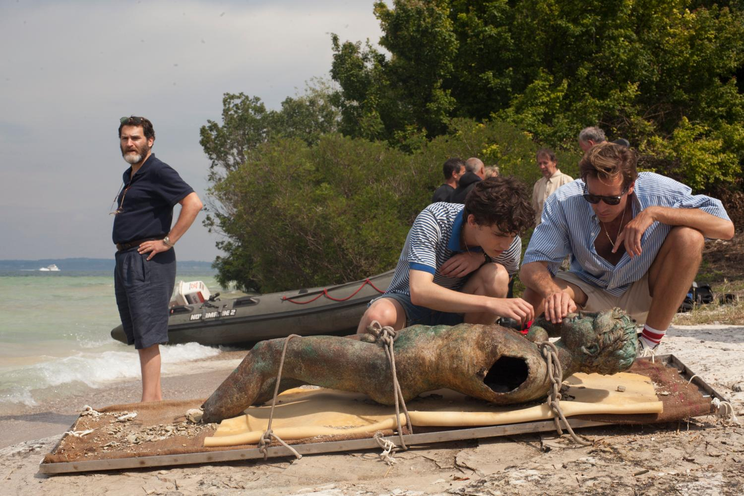 "This image released by Sony Pictures Classics shows, from left, Michael Stuhlbarg, Timothée Chalamet and Armie Hammer in a scene from ""Call Me By Your Name."" (Sony Pictures Classics via AP)"