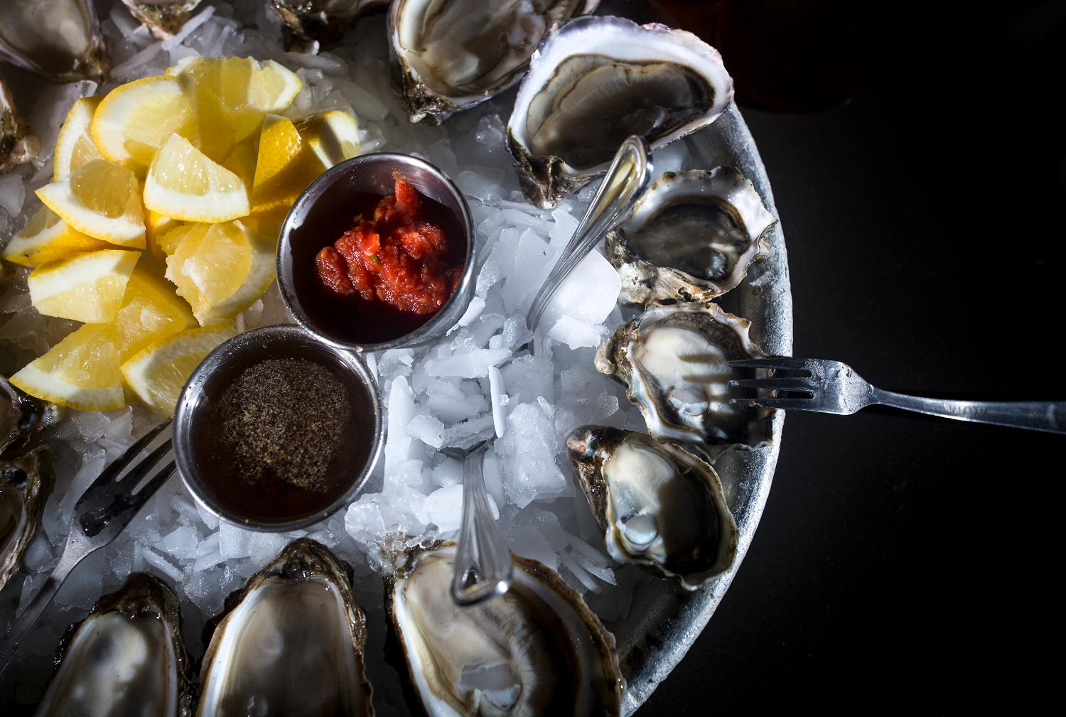 The Kumamoto oysters (right) freshly shucked at Taylor Shellfish's retail shop overlooking Samish Bay, located at 2182 Chuckanut Dr, in Bow, Washington. You can try the tasty oysters at one of their oyster bars located in Queen Anne, Capitol Hill, Pioneer Square, or Bellevue. (Sy Bean / Seattle Refined)