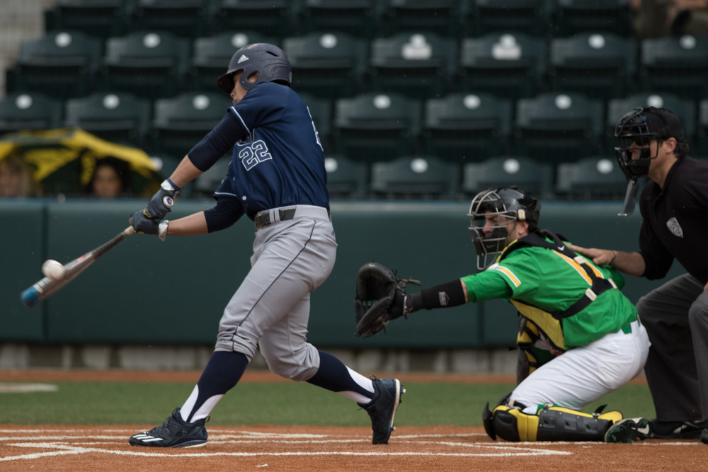 UC Irvine Anteaters infielder Keston Hiura (#22) hits the ball against the Oregon Ducks. Oregon Ducks pitcher Matt Mercer (#11) throws a pitch.  In the second of the three game series, the Ducks beat the UC Irvine Anteaters 6-3. Photo by Austin Hicks, Oregon News Lab