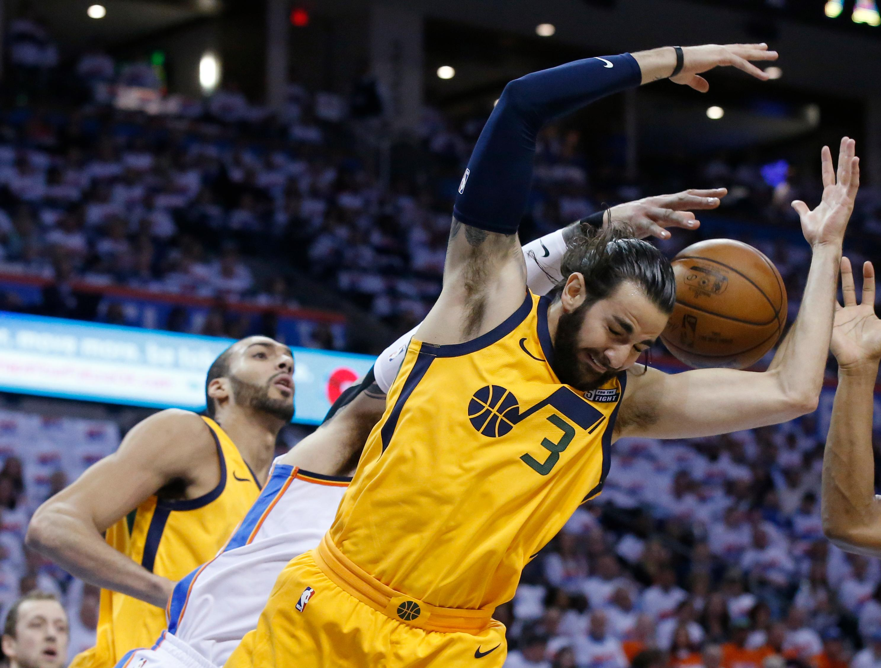 Oklahoma City Thunder center Steven Adams reaches for a rebound behind Utah Jazz guard Ricky Rubio (3) during first half of Game 2 of an NBA basketball first-round playoff series in Oklahoma City, Wednesday, April 18, 2018. (AP Photo/Sue Ogrocki)