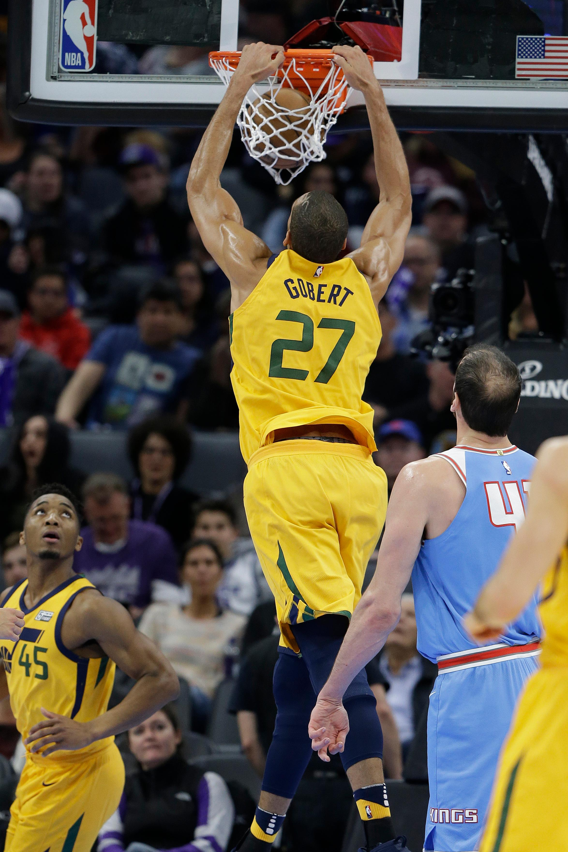 Utah Jazz center Rudy Gobert goes up for the dunk as Sacramento Kings center Kosta Koufos, right, watches during the first quarter of an NBA basketball game Saturday, March 3, 2018, in Sacramento, Calif. (AP Photo/Rich Pedroncelli)
