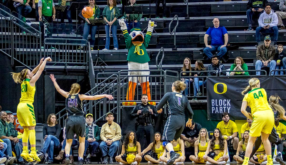 The Duck's Sabrina Ionescu (#20) throws for a three pointer. The Oregon Ducks defeated the Washington Huskies 94-83 on Sunday at Matthew Knight Arena. The victory was Head Coach Kelly Graves' 500th career win. Sabrina Ionescu also set the new NCAA all time record of 8 triple doubles in just 48 games. The previous record was 7 triple doubles in 124 games, held by Susie McConnell at Penn State. The Ducks will next face off against USC on Friday January 5th in Los Angeles. Photo by Rhianna Gelhart, Oregon News Lab