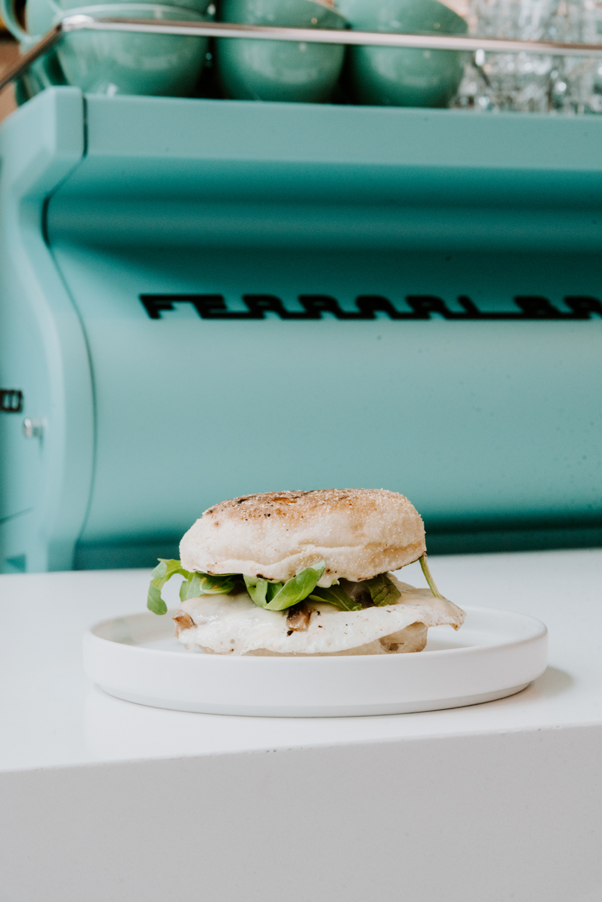 Fried egg sandwich: fluffy English muffin, runny egg, provolone, bacon, and arugula. / Image: Brianna Long // Published: 9.7.19