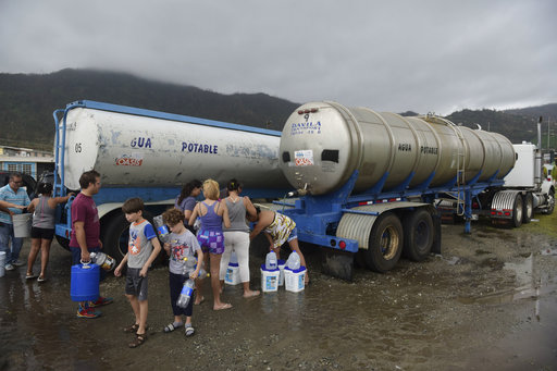 Locals arrive at a water collection point a day after the impact of Hurricane Maria, in Yabucoa, Puerto Rico, Thursday, September 21, 2017. As of Thursday evening, Maria was moving off the northern coast of the Dominican Republic with winds of 120 mph (195 kph). The storm was expected to approach the Turks and Caicos Islands and the Bahamas late Thursday and early Friday. (AP Photo/Carlos Giusti)