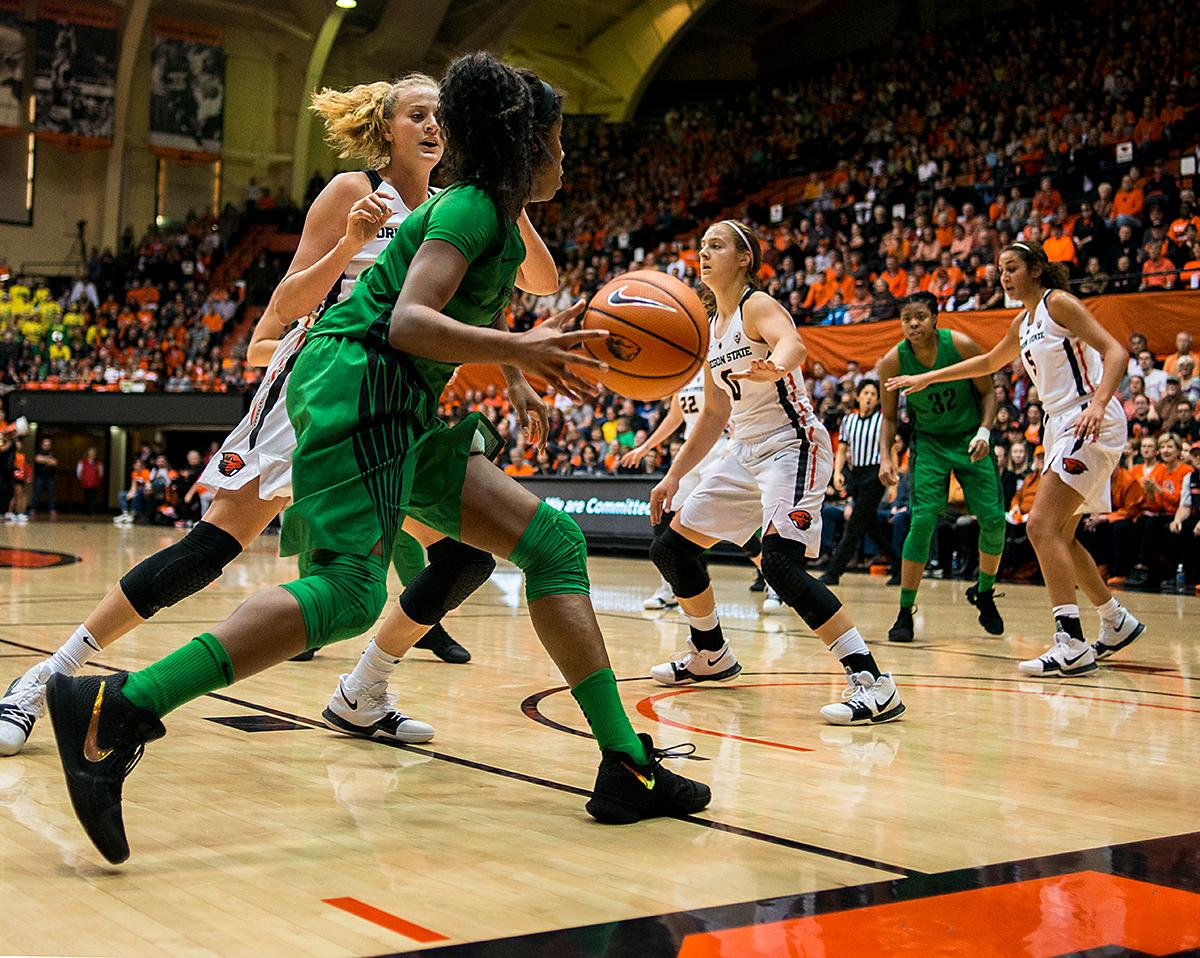 The Oregon Ducks offense drives through the Oregon State Beavers defense to make a shot.The Oregon Ducks were defeated by the Oregon State Beavers 85-79 on Friday night in Corvallis. Sabrina Ionescu scored 35 points and Ruthy Hebard added 24. The Ducks will face the Beavers this Sunday at 5 p.m. at Matthew Knight Arena. Photo by Abigail Winn, Oregon News Lab