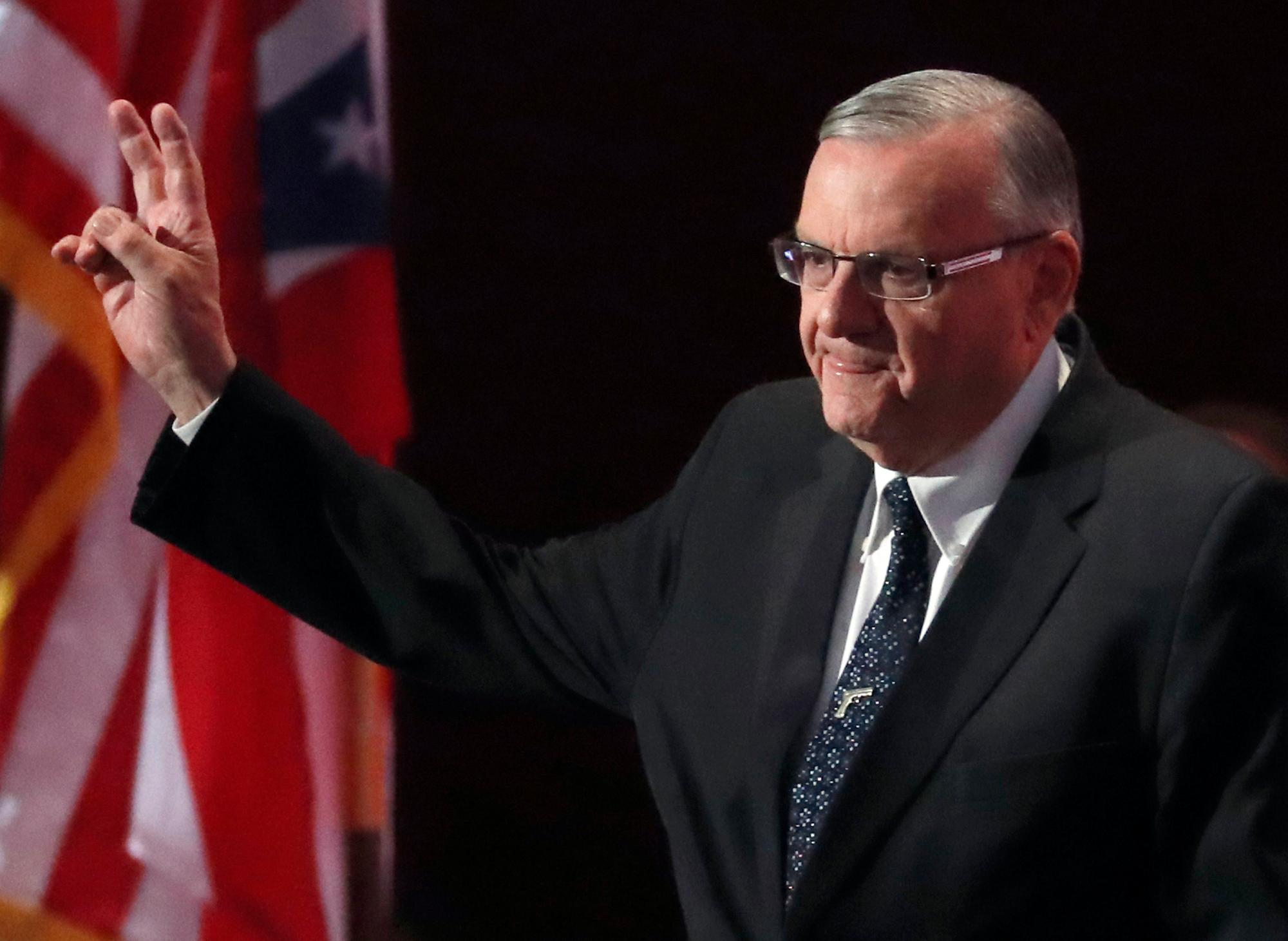 FILE - In this July 21, 2016, file photo, Sheriff Joe Arpaio of Arizona walks on the stage to speak during the final day of the Republican National Convention in Cleveland. Arpaio has been convicted of a criminal charge Monday, July 31, 2017, for disobeying a court order to stop traffic patrols that targeted immigrants in a conviction that marks a final rebuke for the former sheriff and politician who once drew strong popularity from such crackdowns but was booted from office amid voter frustrations over his deepening legal troubles. (AP Photo/Paul Sancya, File)