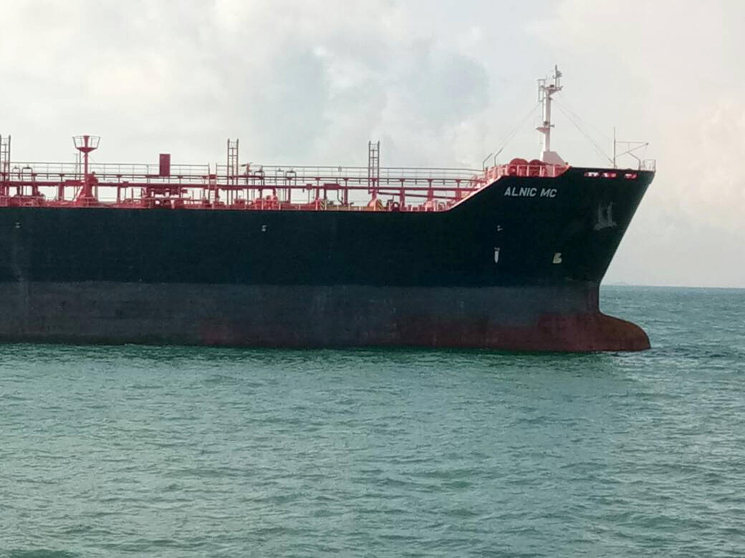 This photo released by the Royal Malaysian Navy shows the oil and chemical tanker Alnic MC is seen after a collision off Johor, Malaysia, Monday, Aug. 21, 2017. A number of U.S. sailors were missing after a collision between the USS John S. McCain and the tanker early Monday east of Singapore, the second accident involving a ship from the Navy's 7th Fleet in the Pacific in two months. (Royal Malaysian Navy via AP)