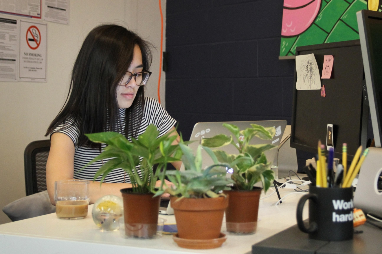 Employees like An-Phuong Ly customize their work spaces. (Amanda Andrade-Rhoades/DC Refined)
