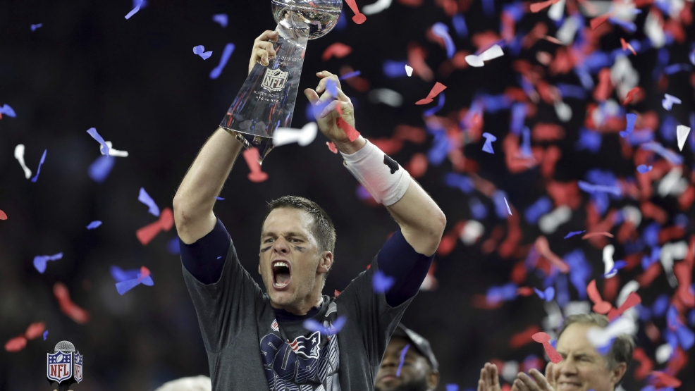 The New England Patriots' Tom Brady raises the Vince Lombardi Trophy after defeating the Atlanta Falcons in overtime at Super Bowl 51 football game Sunday, Feb. 5, 2017, in Houston. The Patriots defeated the Falcons 34-28. THE ASSOCIATED PRESS