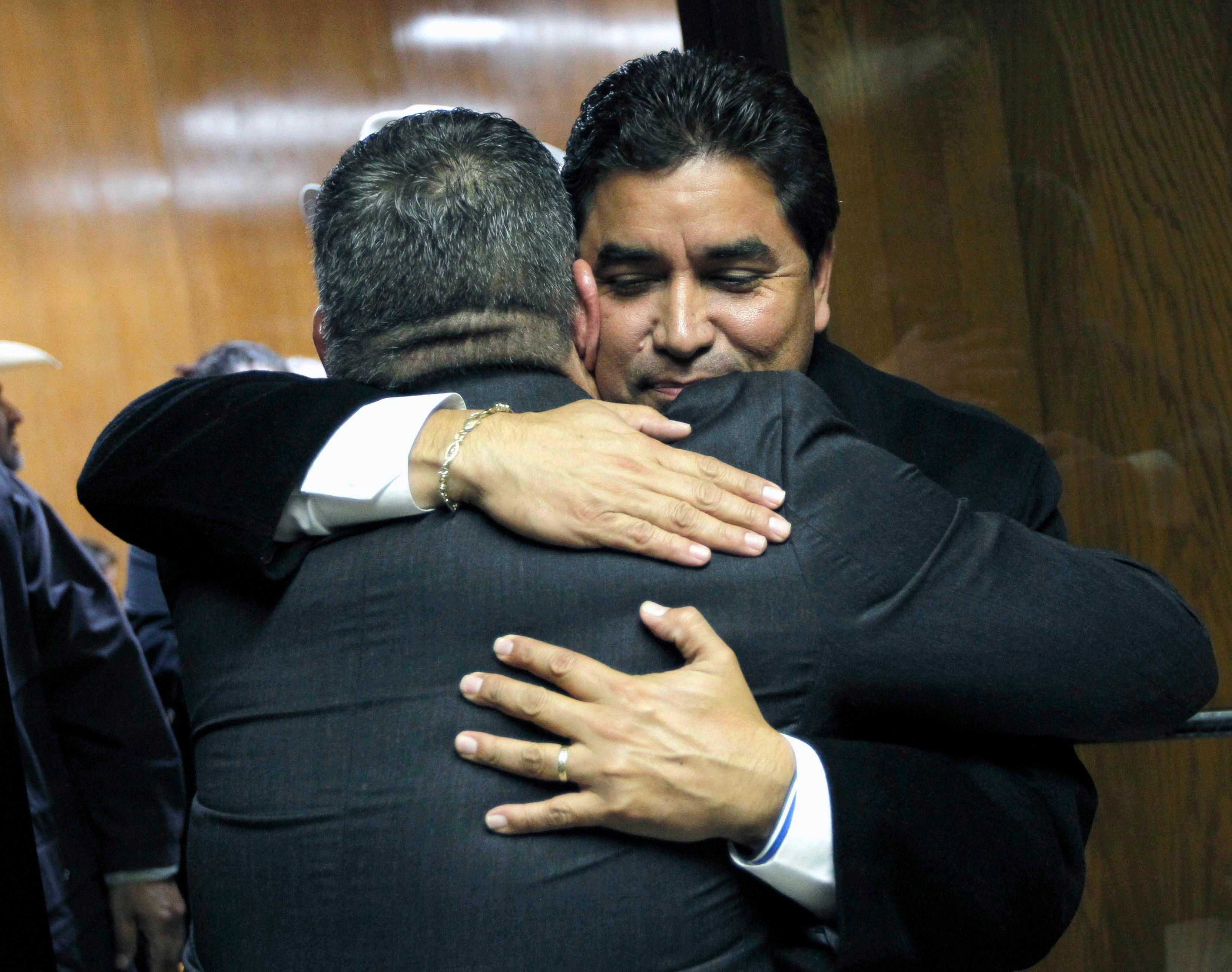 Hidalgo County District Attorney Ricardo Rodriguez hugs Assistant District Attorney Michael Garza following the guilty verdict in John Bernard Feit's trial for the 1960 murder of Irene Garza in the 92nd state District Court Thursday, December 7, 2017, at the Hidalgo County Courthouse in Edinburg.  (Nathan Lambrecht/The Monitor/Pool)