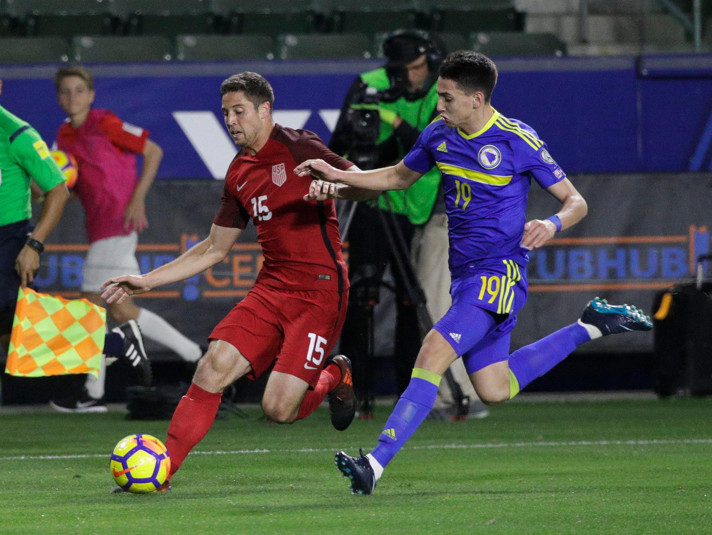 United States defender Matt Polster, left, controls the ball under pressure by Bosnia and Herzegovina forward Luka Menalo during the first half of an international friendly soccer match on Sunday, Jan. 28, 2018, in Carson, Calif. (AP Photo/Jae C. Hong)