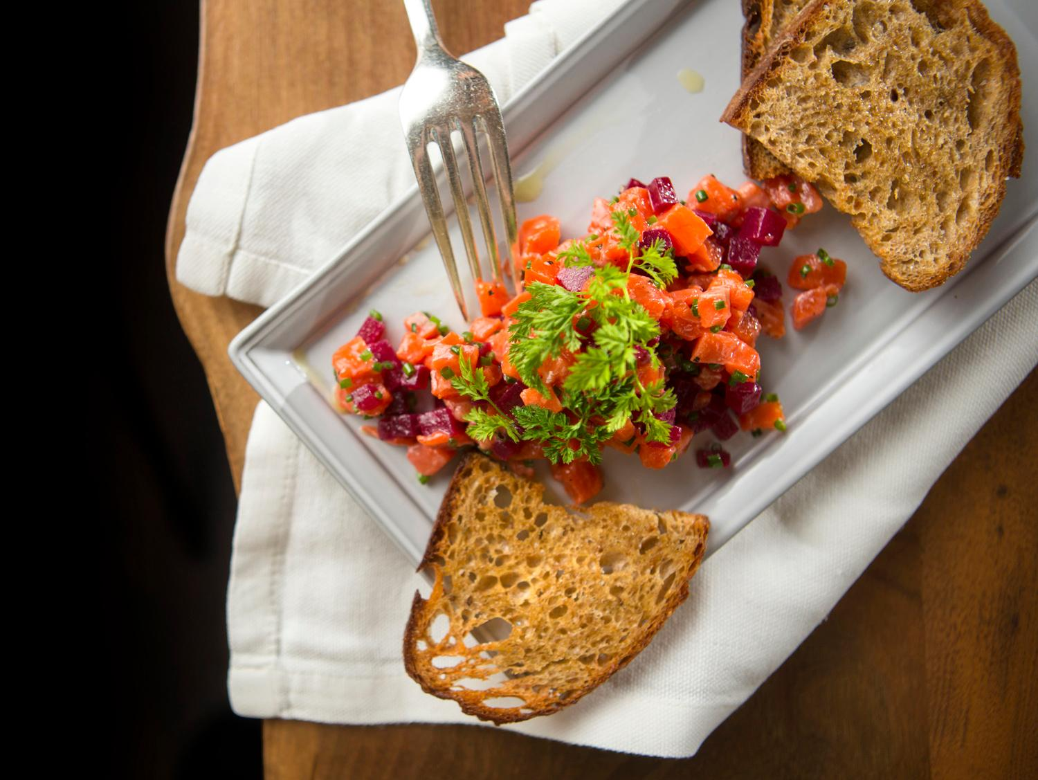 As an appetizer, Chef Joe Ritchie will be serving a Sockey Tartare with smoked red beet and rye crostini, during restaurant week at Goldfinch Tavern at the Four Seasons Hotel. Other appetizers included Shaved Asparagus Salad and Half Shell Pacific Oysters. (Sy Bean / Seattle Refined)
