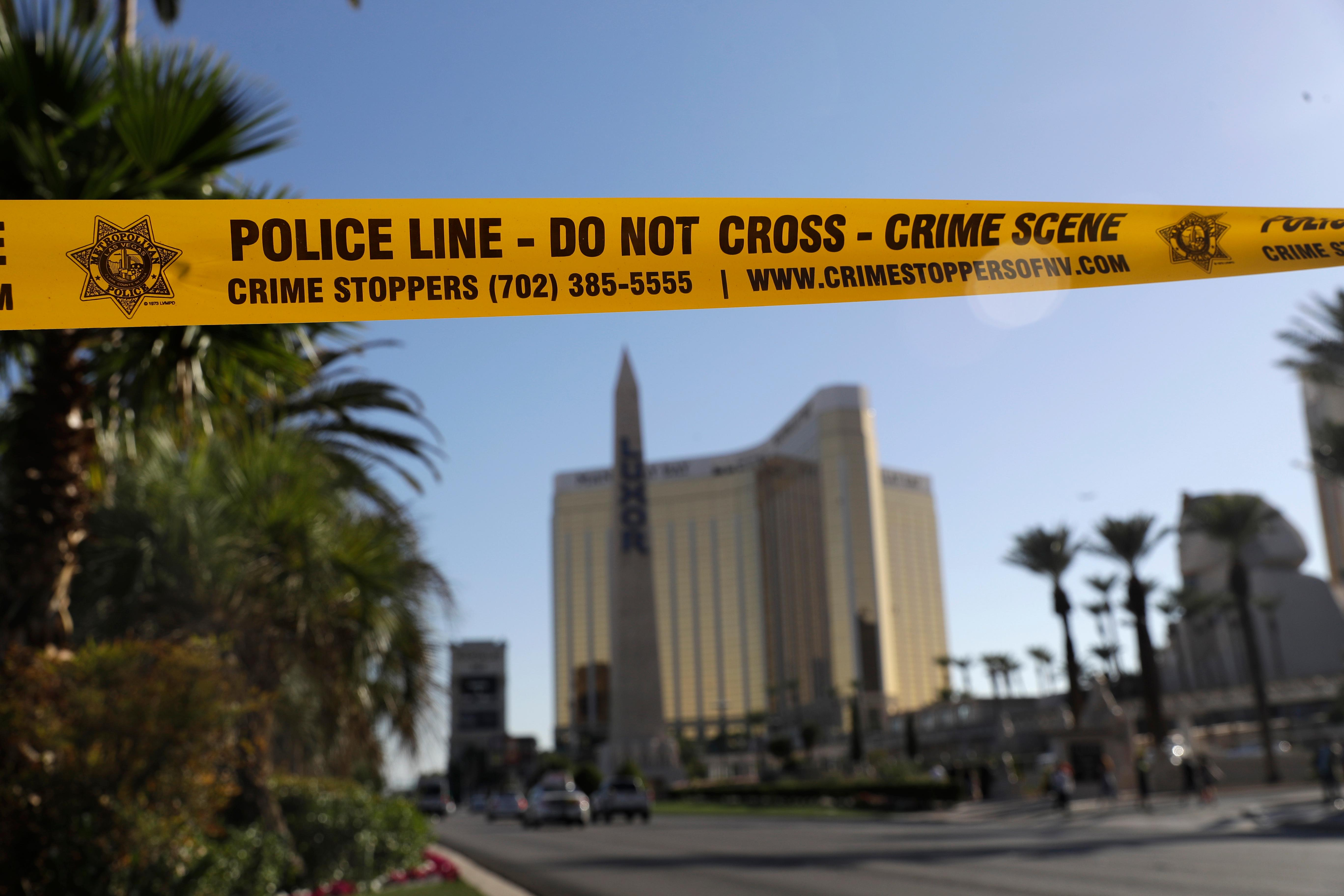 Part of Reno Ave. near South Las Vegas Blvd is blocked with police tape in the aftermath of a mass shooting Wednesday, Oct. 4, 2017, in Las Vegas. (AP Photo/Marcio Jose Sanchez)<p></p>