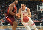 Wisconsin guard Bronson Koenig (24) drives to the basket against Virginia Tech forward Zach LeDay (32) during the first half of a first-round game in the NCAA Tournament, Thursday, March 16, 2017, in Buffalo, N.Y.