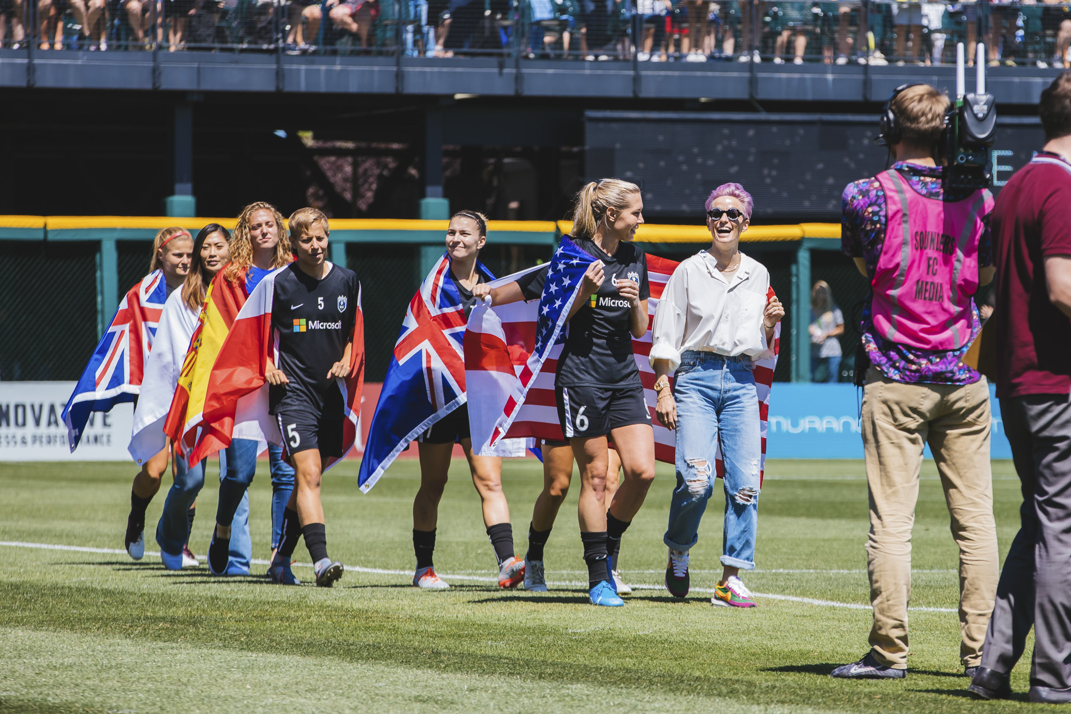 <p>World Cup champions Megan Rapinoe and Allie Long were welcomed back to their home team the Seattle Reign FC on Sunday, July 28 at their first match back after their phenomenal{&nbsp;} World Cup{&nbsp;} win. While neither played this game, proud fans filled a sold-out Cheney Stadium in Tacoma, where 7,000+ watched as the Reign took on the Chicago Red Stars. (Image: Sunita Martini / Seattle Refined)</p>