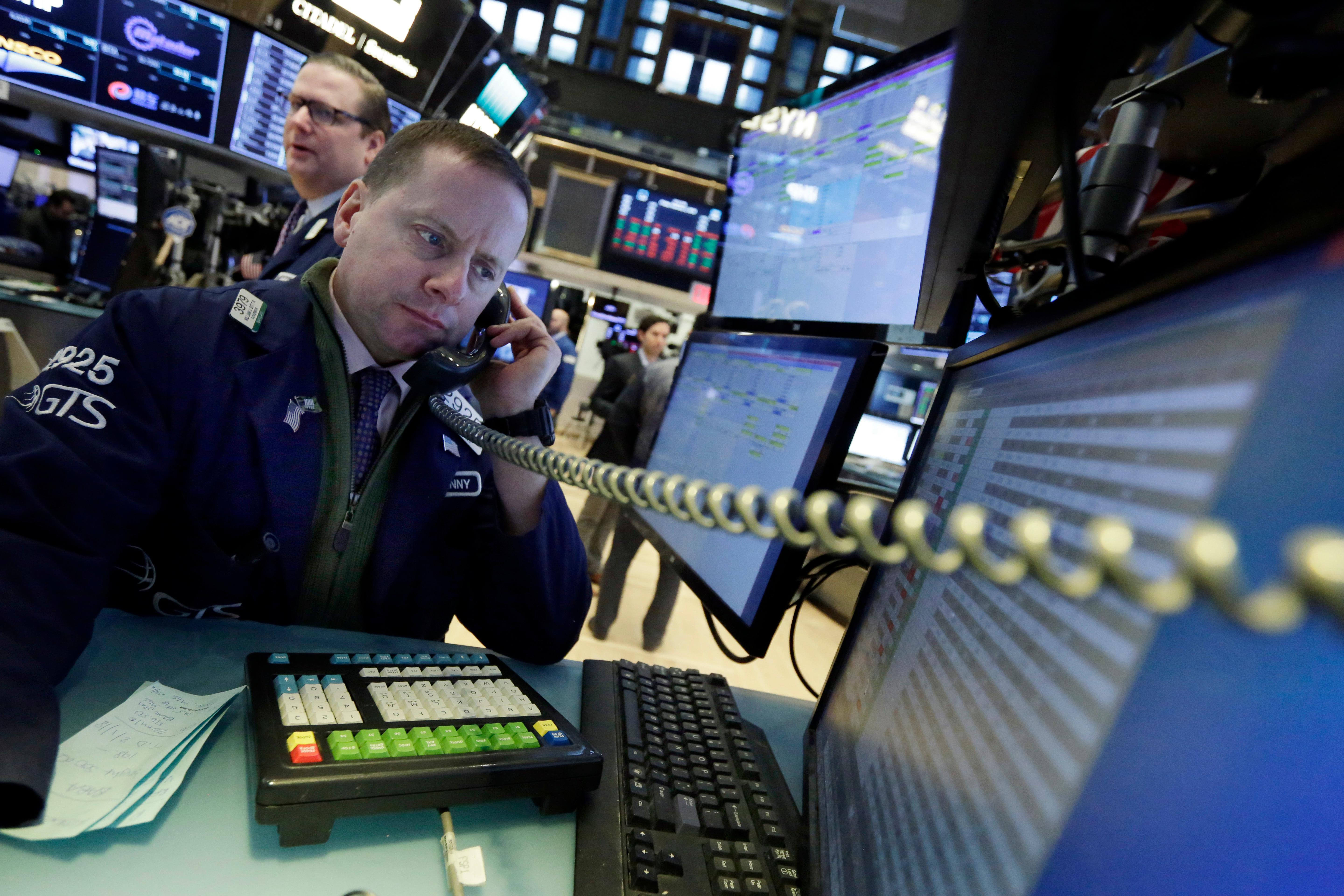 Specialist Robert Nelson works at his post on the floor of the New York Stock Exchange, Friday, Feb. 2, 2018. Technology companies were leading stocks broadly lower in early trading, extending the market's slide into a second day. (AP Photo/Richard Drew)