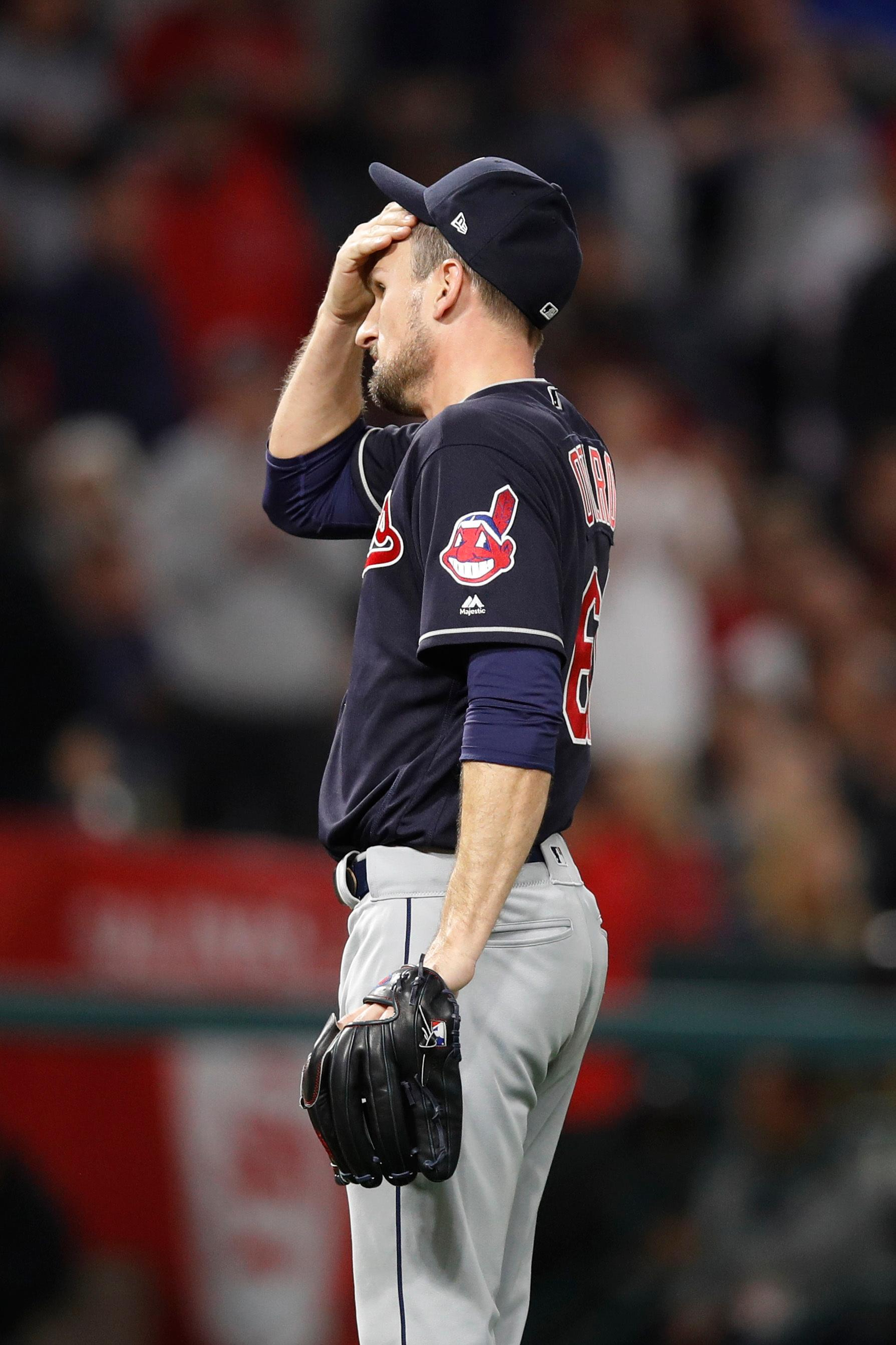 Cleveland Indians relief pitcher Dan Otero wipes his face after giving up a two-RBI double against Los Angeles Angels' Rene Rivera during the fifth inning of a baseball game, Tuesday, April 3, 2018, in Anaheim, Calif. (AP Photo/Jae C. Hong)
