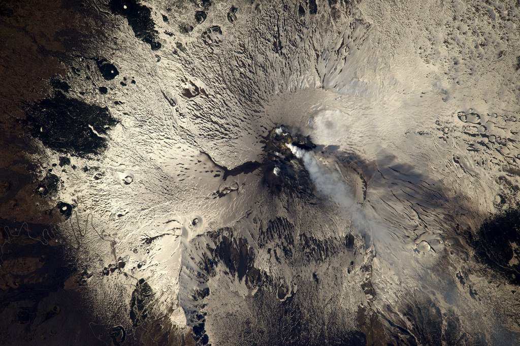 Mount Etna is erupting these days.. Not the best time to take that little zigzag road you can see on the left ;) (Photo & Caption: Thomas Pesquet // NASA)