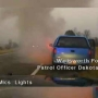 VIDEO: Officer helps woman from burning car