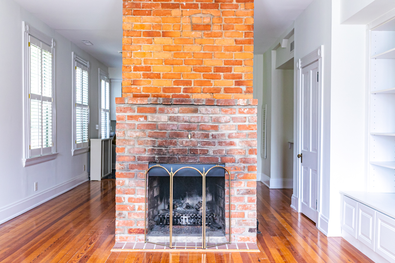 The fireplace is original, too, but upgraded to gas for convenience.{ }/ Image: Amy Spasoff // Published: 5.22.19