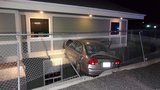 Car Pursuit ends with the car crashing into a building and dangling 10 feet in the air