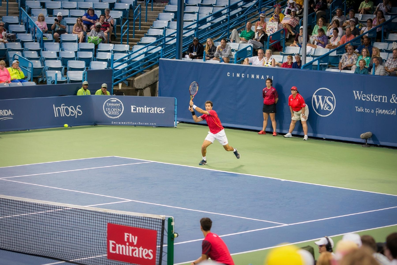 "The Western & Southern Open continued the tennis action on Saturday night (August 20) for the men's semis. It was also the night of the annual ""Affair at the Open,"" a young professional party that includes chartered buses from Rhinegeist in Over-the-Rhine to the tennis facility in Mason. / Image: Mike Bresnen Photography"