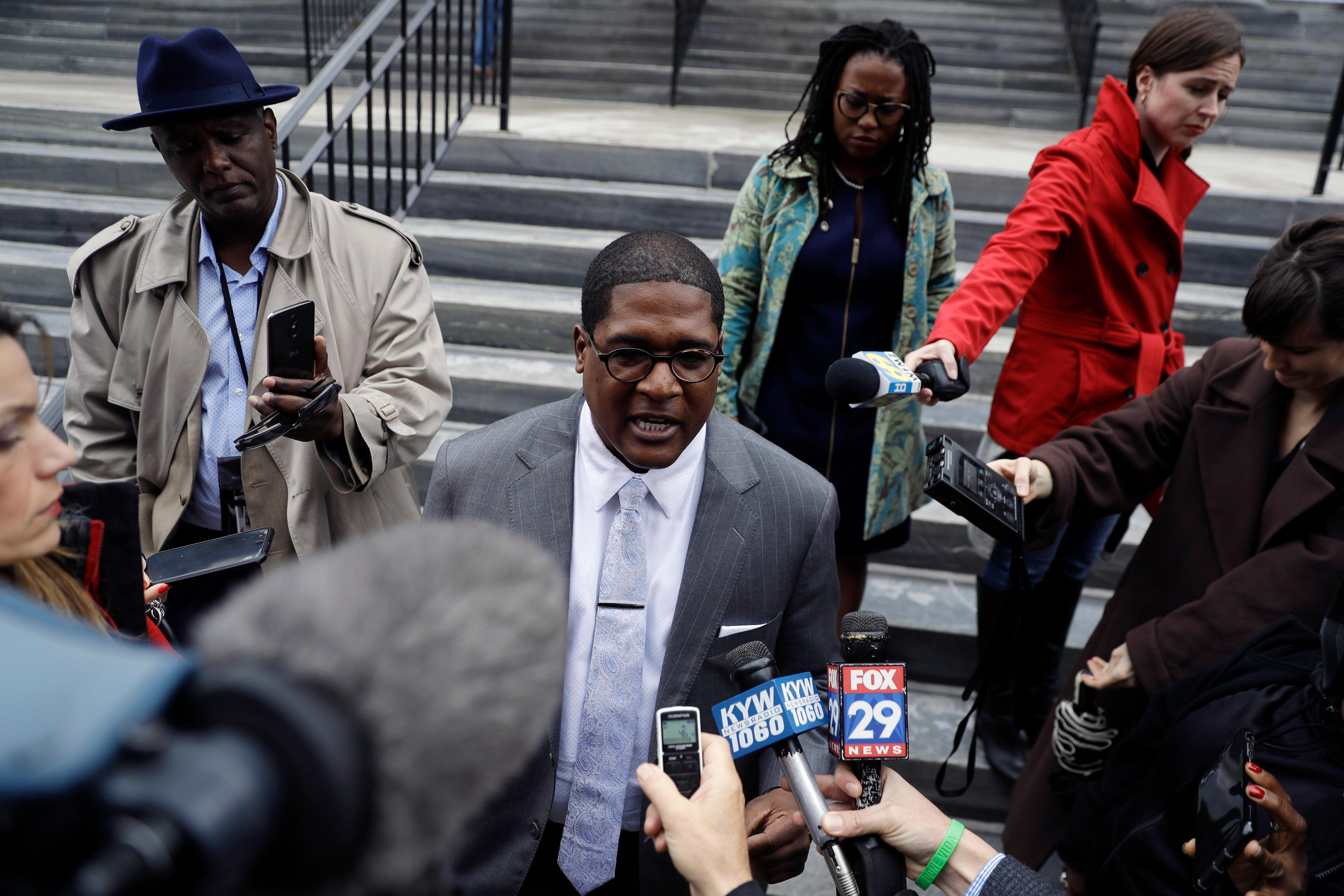 Bill Cosby's spokesman Andrew Wyatt speaks to the media outside the Montgomery County Courthouse during a break in Cosby's sexual assault retrial, Monday, April 16, 2018, in Norristown, Pa. (AP Photo/Matt Slocum)