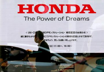 Honda's profit drops on air bag recall expenses, flat sales