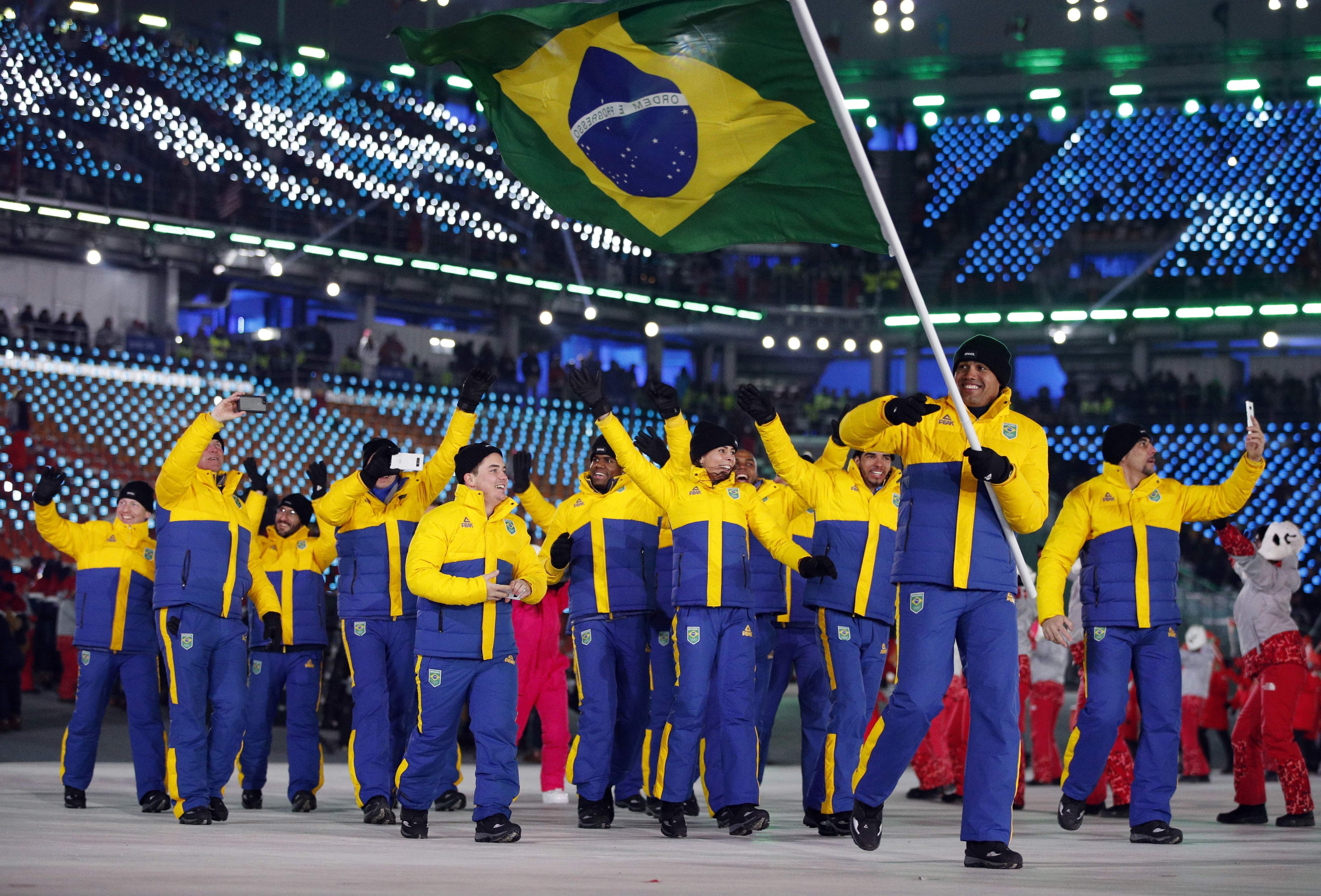 Edson Bindilatti carries the flag of Brazil during the opening ceremony of the 2018 Winter Olympics in Pyeongchang, South Korea, Friday, Feb. 9, 2018. (AP Photo/Jae C. Hong)