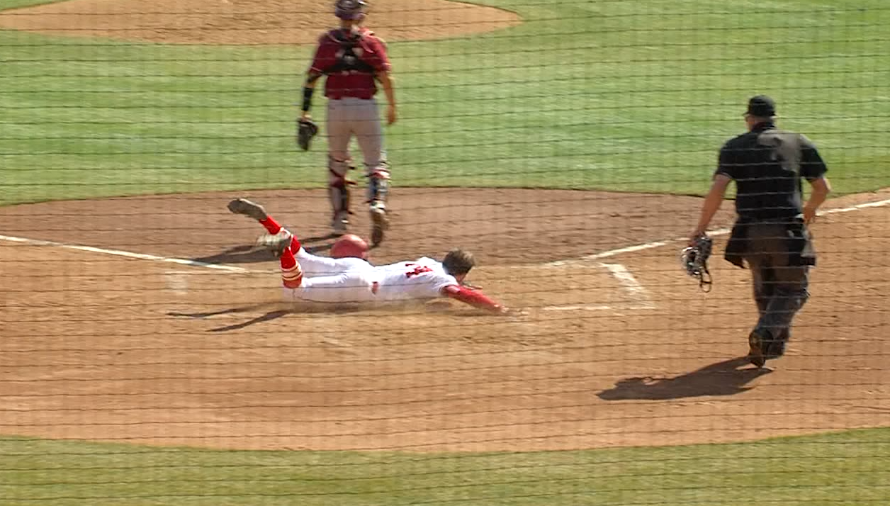 Alex Raburn slides in safely for Nebraska on March 19, 2017 (NTV News)